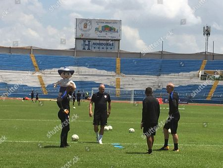 U.S. soccer goalkeepers Tim Howard, left, Nick Rimando, second from right, Brad Guzman, right, and goalkeeper coach Matt Reis, second from left, practice at Estadio Olimpico Metropolitano in San Pedro Sula, Honduras Mpnday, . After another stunning home loss, the United States has left itself little margin for error in its last three World Cup qualifiers, starting with Tuesday afternoon's match in the tropical heat and humidity of Honduras