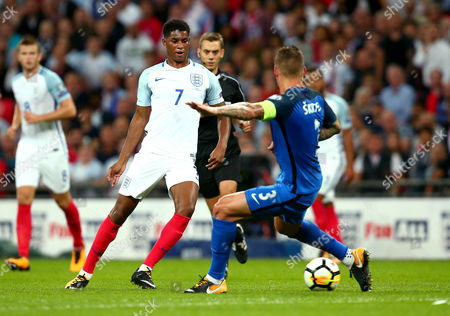 Marcus Rashford of England takes on Martin Skrtel of Slovakia