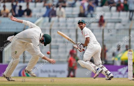 Bangladesh's Nasir Hossain, right, plays a shot during the second day of their second test cricket match against Australia in Chittagong, Bangladesh