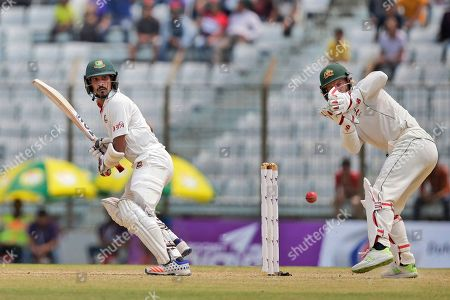 Nasir Hossain, Matthew Wade Bangladesh's Nasir Hossain, left, plays a shot, as Australia's wicketkeeper Matthew Wade follows the ball during the second day of their second test cricket match in Chittagong, Bangladesh