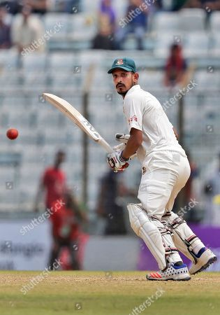 Bangladesh's Nasir Hossain plays a shot during the second day of their second test cricket match against Australia in Chittagong, Bangladesh