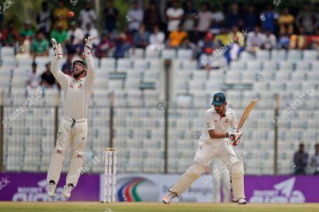 Matthew Wade, Nasir Hossain Australia's wicketkeeper Matthew Wade, left, throws the ball after taking a catch successfully to dismiss Bangladesh's Nasir Hossain, right, during the second day of their second test cricket match in Chittagong, Bangladesh