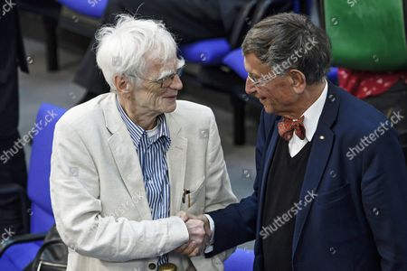 The Green Party parliamentarian Hans-Christian Stroebele (L) and the former Minister of Scientific Research of the Christian Democratic Union (CDU), Heinz Riesenhuber (R) shake hands in farewell during a session of the German Bundestag in Berlin, Germany, 05 September 2017. Both MPs will not run re-election and leave the Bundestag, 78-year-old Stroebele after 21 years and 91-year-old Riesenhuber after 41 years. The German lower house, the Bundestag convenes for its last session of the current legislative period before the next general elections held on 24 September. The session's agenda is topped by a debate on the state of the nation including the government's and the opposition's works.