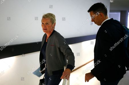 """French journalists Elise Lucet, center, and Laurent Richard arrive at their trial Tuesday, Sept.5, 2017 in Nanterre, outside Paris. The two journalists are on trial accused by Azerbaijan's government of defamation for calling the country a """"dictatorship."""" following a 2015 investigative report"""