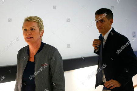 """French journalists Elise Lucet, left, and Laurent Richard arrive at their trial Tuesday, Sept.5, 2017 in Nanterre, outside Paris. The two journalists are on trial accused by Azerbaijan's government of defamation for calling the country a """"dictatorship."""" following a 2015 investigative report"""