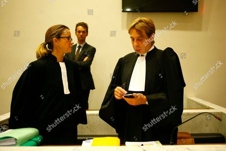 """Lawyers for Azerbaijan Laurence Dauxin, left, and Olivier Pardo wait in the courtroom, Tuesday, Sept.5, 2017 in Nanterre, outside Paris. French journalists Elise Lucet and Laurent Richard are on trial accused by Azerbaijan's government of defamation for calling the country a """"dictatorship."""" following a 2015 investigative report"""