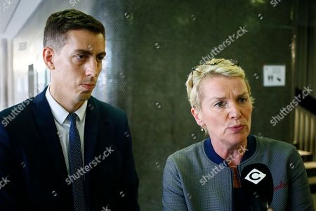 """Stock Image of French journalists Elise Lucet, right, and Laurent Richard answer reporters during their trial Tuesday, Sept.5, 2017 in Nanterre, outside Paris. The two journalists are on trial accused by Azerbaijan's government of defamation for calling the country a """"dictatorship."""" following a 2015 investigative report"""