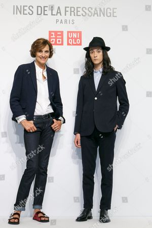 (L to R) French model and fashion designer Ines de la Fressange and fashion model Louis Kurihara, pose for the cameras during a media event for Uniqlo x Ines de la Fressange AW17 collection