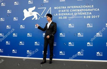 Actor Fukuyama Masaharu poses during the photo call of the film 'Sandome No Satsujin' (The Third Murder), at the 74th edition of the Venice Film Festival, in Venice, Italy