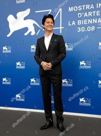 Stock Photo of Actor Fukuyama Masaharu poses during the photo call of the film 'Sandome No Satsujin' (The Third Murder), at the 74th edition of the Venice Film Festival, in Venice, Italy