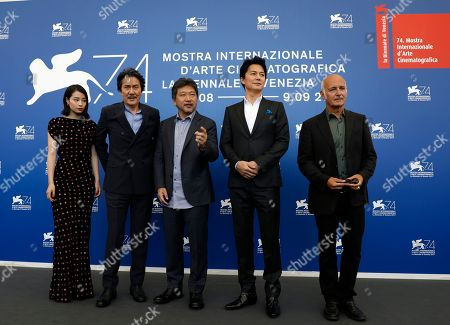 From left, actress Hirose Suzu, actor Yakusho Koji, director Kore-eda Hirokazu, actor Fukuyama Masahara and composer Ludovico Einaudi pose during the photo call of the film 'Sandome No Satsujin' (The Third Murder), at the 74th edition of the Venice Film Festival, in Venice, Italy