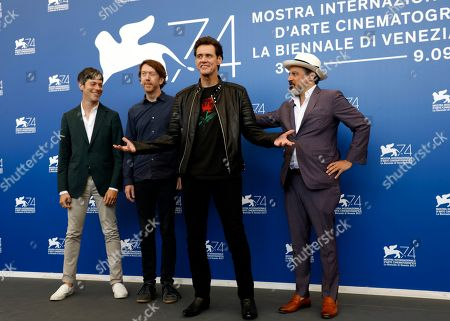 From left, producer Danny Gabai, director Chris Smith, actor Jim Carrey and producer Eddy Moretti pose for photographers during the photo call of the film 'Jim & Andy: The Great Beyond - The Story of Jim Carrey & Andy Kaufman Featuring a Very Special, Contractually Obligated Mention of Tony Clifton', at the 74th edition of the Venice Film Festival, in Venice, Italy