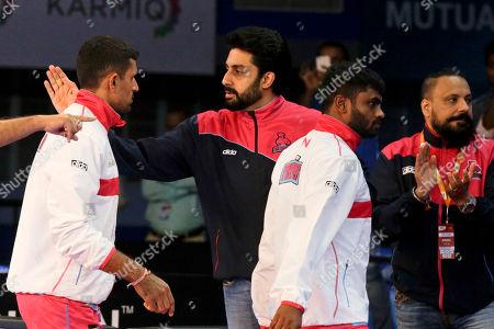 Bollywood actor Abhishek Bachchan, owner of Jaipur Pink Panthers team, greets his players during their Vivo Pro Kabaddi league match against Patna Pirates in Kolkata, India