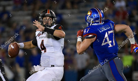 Jesse Hosket, Keith Loneker Jr. Southeast Missouri State Redhawks quarterback Jesse Hosket (4) is pressured by Kansas linebacker Keith Loneker Jr. (47) during the second half of an NCAA college football game in Lawrence, Kan