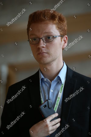Ross Greer makes his way to the Debating Chamber