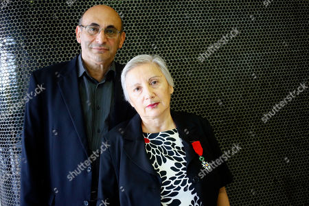 """Dr. Leyla Yunus, of the Institute for Peace and Democracy of Azerbaijan, right, with her medal of Chevalier of the French Legion of Honor poses with her husband Arif Yunus pose prior to the trial of French journalists Elise Lucet and Laurent Richard at the court in Nanterre, outside Paris, Tuesday, Sept.5, 2017. French journalists Lucet and Laurent Richard are on trial accused by Azerbaijan's government of defamation for calling the country a """"dictatorship."""" following a 2015 investigative report"""