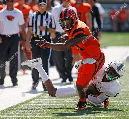 Artavis Pierce, Chris Seisay. Oregon State running back Artavis Pierce (21) and Portland State corner back Chris Seisay (9) during an NCAA college football game, in Corvallis, Ore