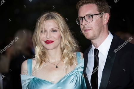 Courtney Love, Nicholas Cullinan. Courtney Love and Nicholas Cullinan pose for photographers upon arrival at the GQ's Men of The Year awards, in London