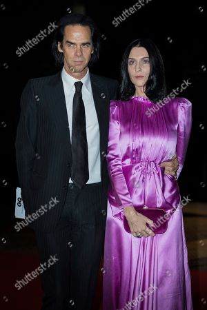 Nick Cave, Susie Bick. Nick Cave and Susie Bick pose for photographers upon arrival at the GQ's Men of The Year awards, in London
