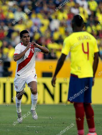 Peru's Paolo Hurtado celebrates his goal against Ecuador during a Russia 2018 WCup qualifier soccer match in Quito, Ecuador, . At right is Ecuador's Pedro Velasco