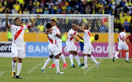 Peru's soccer team celebrates their 2-1 victory over Ecuador at the end of their Russia 2018 WCup qualifier soccer match in Quito, Ecuador, . From left are Paolo Guerrero, Wilder Cartagena and Yoshimar Yotun