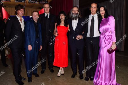 Stock Image of George Vjestica, Thomas Wydler, Jim Sclavunos, Warren Ellis with his wife  Delphine Ciampi Ellis, Nick Cave with his wife Susie Bick