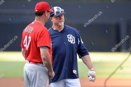 San Diego Padres' Mark McGwire, right, and St. Louis Cardinals' John Mabry talk before a baseball game, in San Diego