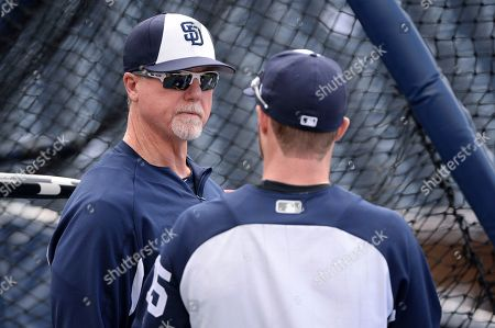 San Diego Padres' Mark McGwire, left, and Cory Spangenberg talk during batting practice before the baseball game against the St. Louis Cardinals, in San Diego
