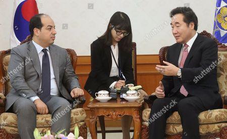 Ahmed Maiteeq and Lee Nak-yon