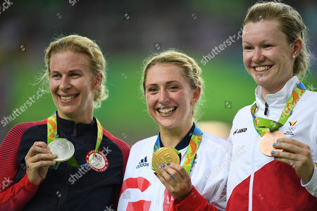 Laura Trott Of Team Gb Wins The Gold Medal With Jolien D'hoore Of Belgium Bronze (l) And Sarah Hammer Of Usa (r) And Celebrates In The Women's Omnium At The Rio Olympics Brazil.