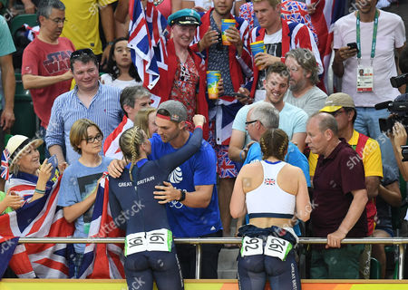 Stock Picture of Rebecca James Hugs Rugby Player George North (l). Rebecca James (l) And Katy Marchant Of Team Gb Celebrates Gold And Silver In The Women's Sprint At The Rio Olympics Brazil.