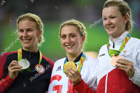 Rio 2016: Laura Trott Of Team Gb Wins The Gold Medal With Jolien D'hoore Of Belgium Bronze (l) And Sarah Hammer Of Usa (r) And Celebrates In The Women's Omnium At The Rio Olympics Brazil.