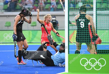 Stock Image of Rio 2016 Olympics Brazil Women's Team Gb Hockey Gb V New Zealand Semi Final. Georgie Twigg Celebrates As Alex Danson Scores For Gb.