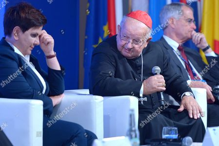 Polish Prime Minister Beata Szydlo (L) and Cardinal Stanislaw Dziwisz (C) attend the plenary session 'Politics. A Matter of Values or Interests?' of the XXVII Economic Forum in Krynica Zdroj, southern Poland, 06 September 2017. The Forum will run until 07 September.