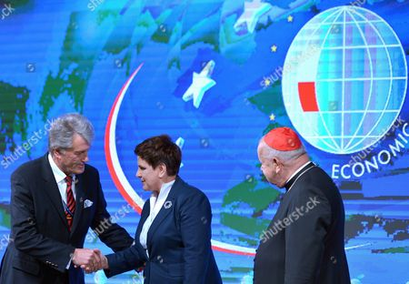 Former Ukrainian President Viktor Yushchenko (L) welcomes Polish Prime Minister Beata Szydlo (C) and Cardinal Stanislaw Dziwisz (R) before the plenary session 'Politics. A Matter of Values or Interests?' of the XXVII Economic Forum in Krynica Zdroj, southern Poland, 06 September 2017. The Forum will run until 07 September.