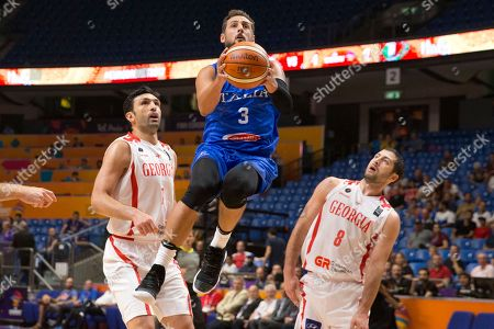 Marco Belinelli, Zaza Pachulia, George Tsintsadze. Italy's Marco Belinelli, centre, goes to the basket between Georgia's Zaza Pachulia, left, and George Tsintsadze during their Eurobasket European Basketball Championship Group B match in Tel Aviv, Israel