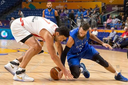 Luigi Datome, Zaza Pachulia. Italy's Luigi Datome, right, fights for the ball with Georgia's Zaza Pachulia during their Eurobasket European Basketball Championship Group B match in Tel Aviv, Israel