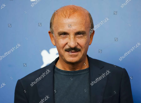 """Actor Carlo Buccirosso poses for photographers during the photo call of the film """"Ammore E Malavita"""" at the 74th Venice Film Festival in Venice, Italy"""