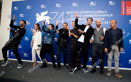 """From left, Luca Tommassini, Serena Rossi, Marco Manetti, Antonio Manetti, Claudia Gerini, Giampaolo Morelli, Raiz and Carlo Buccirosso pose for photographers during the photo call of the film """"Ammore E Malavita"""" at the 74th Venice Film Festival in Venice, Italy"""