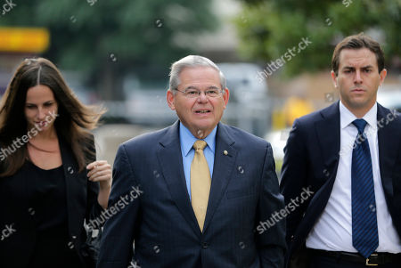Robert Menendez, Alicia Menendez, Robert Menendez Jr. Senator Bob Menendez, center, arrives with his children, Alicia Menendez and Robert Menendez Jr., to court for his federal corruption trial in Newark, N.J., . The trial will examine whether he lobbied for Florida ophthalmologist Dr. Salomon Melgen's business interests in exchange for political donations and gifts. Both have pleaded not guilty