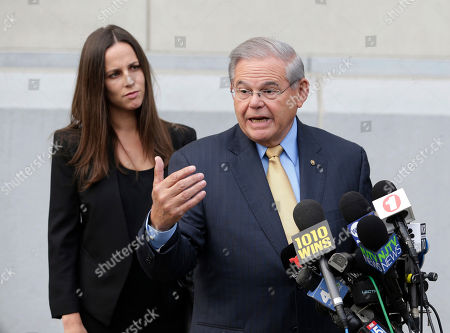 Robert Menendez, Alicia Menendez. While his daughter Alicia Menendez looks, Senator Bob Menendez talk to reporters as he arrives to court for his federal corruption trial in Newark, N.J., . The trial will examine whether he lobbied for Florida ophthalmologist Dr. Salomon Melgen's business interests in exchange for political donations and gifts. Both have pleaded not guilty