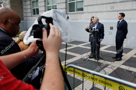 Robert Menendez, Alicia Menendez, Robert Menendez Jr. Senator Bob Menendez, second from right, talks to reporters while his children, Alicia Menendez and Robert Menendez Jr., look on outside the courthouse in Newark, N.J., . The corruption trial for the New Jersey Democrat and a wealthy Florida eye doctor begins on Wednesday in Newark. The trial will examine whether Menendez was illegally lobbying for Salomon Melgen, who gave him political contributions and gifts including luxury vacations