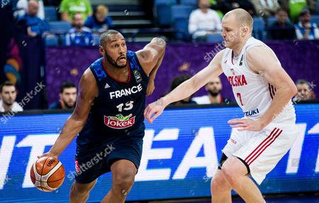 Boris Diaw of France vs Damian Kulig of Poland