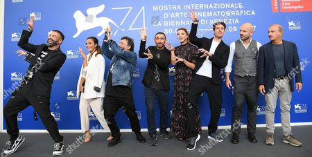 (L-R) Luca Tomassini, Serena Rossi, Antonio and Marco Manetti (Manetti Bros), Claudia Gerini,  Giampaolo Morelli, Raiz and Carlo Buccirosso,  pose during a photocall for 'Ammore e Malavita' during the 74th Venice Film Festival in Venice, Italy, 06 September 2017. The movie is presented in the official competition 'Venezia 74' at the festival running from 30 August to 09 September 2017.