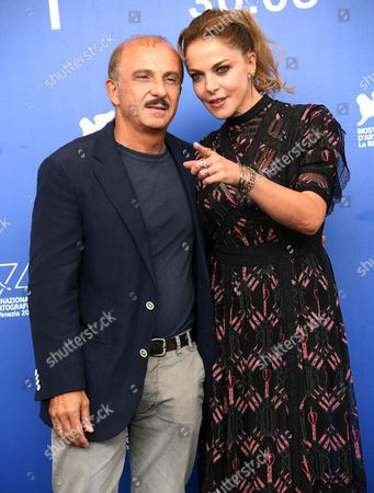 Italian actors Claudia Gerini (R) and Carlo Buccirosso pose during a photocall for 'Ammore e Malavita' during the 74th Venice Film Festival in Venice, Italy, 06 September 2017. The movie is presented in the official competition 'Venezia 74' at the festival running from 30 August to 09 September 2017.