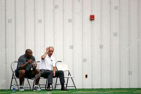 Ozzie Newsome, Dick Cass. Baltimore Ravens general manager and executive vice president Ozzie Newsome, left, and team president Dick Cass watch an NFL football practice in Owings Mills, Md., . Quarterback Joe Flacco is combining all of training camp and four preseason games into one week of practice before testing his ailing back for the first time in Sunday's season opener at Cincinnati