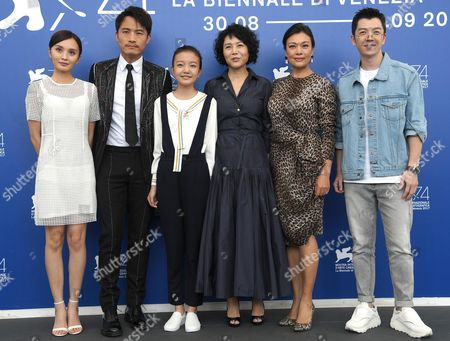 (L-R) Chinese actors Peng Jing, Geng Le, Zhou Meijung, Chinese director Vivian Qu, Shi Ke and Wang Yuexin pose during a photocall for 'Jia Nian Hua (Angels wear white)' during the 74th Venice Film Festival, in Venice, Italy, 07 September 2017. The movie is presented in the official competition 'Venezia 74' at the festival running from 30 August to 09 September 2017.