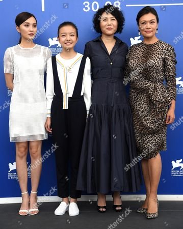 (L-R) Chinese actresses Peng Jing, Zhou Meijung, Chinese director Vivian Qu and actress Shi Ke pose during a photocall for 'Jia Nian Hua (Angels wear white)' during the 74th Venice Film Festival, in Venice, Italy, 07 September 2017. The movie is presented in the official competition 'Venezia 74' at the festival running from 30 August to 09 September 2017.
