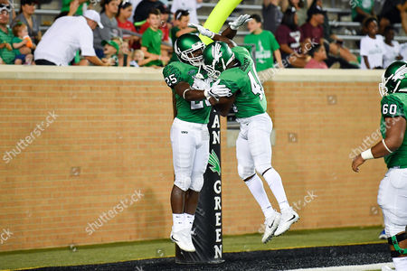 North Texas Mean Green running back Andrew Tucker (25) celebrates with North Texas Mean Green running back Christian Hosley (46) after a touchdown during an NCAA Football game between the Lamar Cardinals and the North Texas Mean-Green Eagles at Apogee Stadium in Denton, Texas