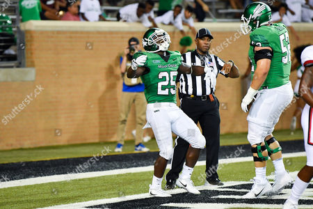 North Texas Mean Green running back Andrew Tucker (25) celebrates after a touchdown during an NCAA Football game between the Lamar Cardinals and the North Texas Mean-Green Eagles at Apogee Stadium in Denton, Texas